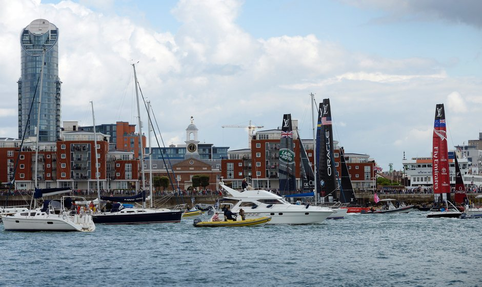 Americas cup yachts leaving harbour