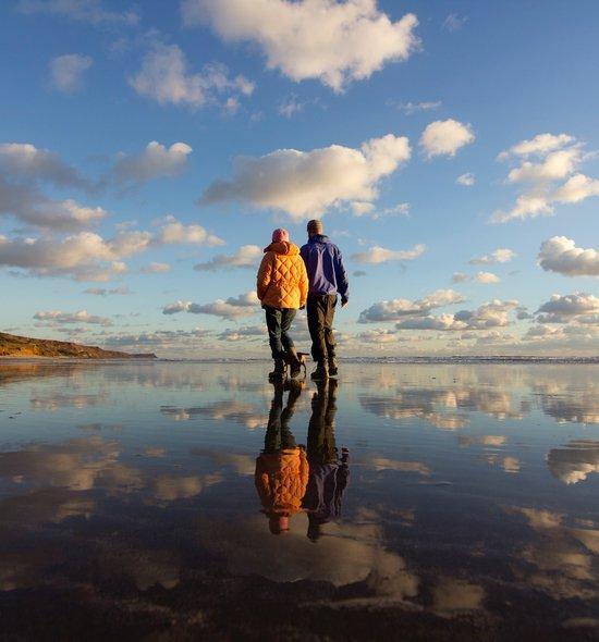 Beach walk reflected clouds