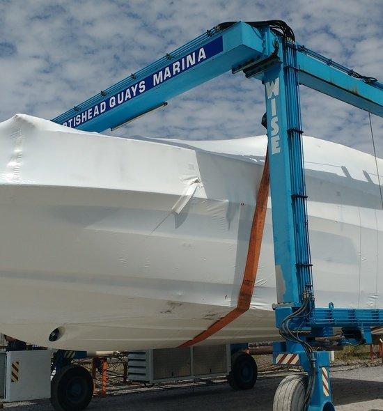 New boat wrapped on hoist at Portishead marina